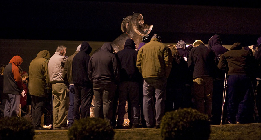 Strasburg residents show their support during a prayer vigil held Tuesday next to the ram statue near the high school gymnasium.  Rich Cooley/Daily